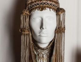 Bridal Headdress (Gargush), Ear Ornaments (Akvat) and Necklace (Lebbe) 20th century, Sana'a, Yemen Brocade, cotton, glass beads, pearl beads, turquoise, gilded silver and metal Donated by Felix and Dora Hiller Jewish Museum of Australia Collection 2869